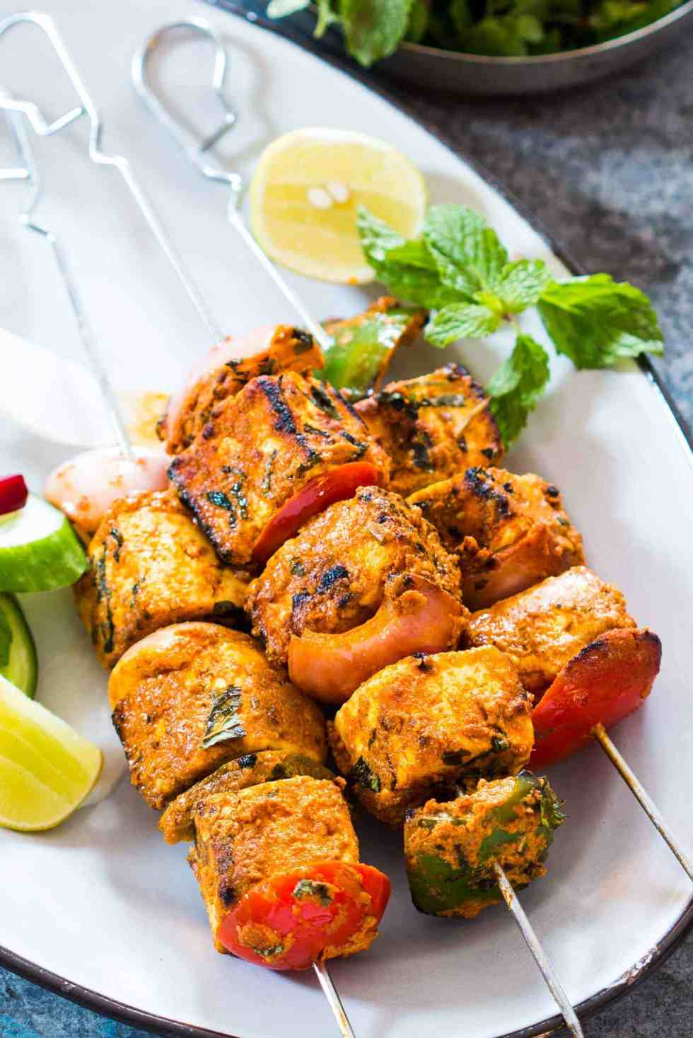 This is the best Tandoori Paneer Tikka in the oven you'll ever make at home! Same restaurant style taste, but roasted in the oven.