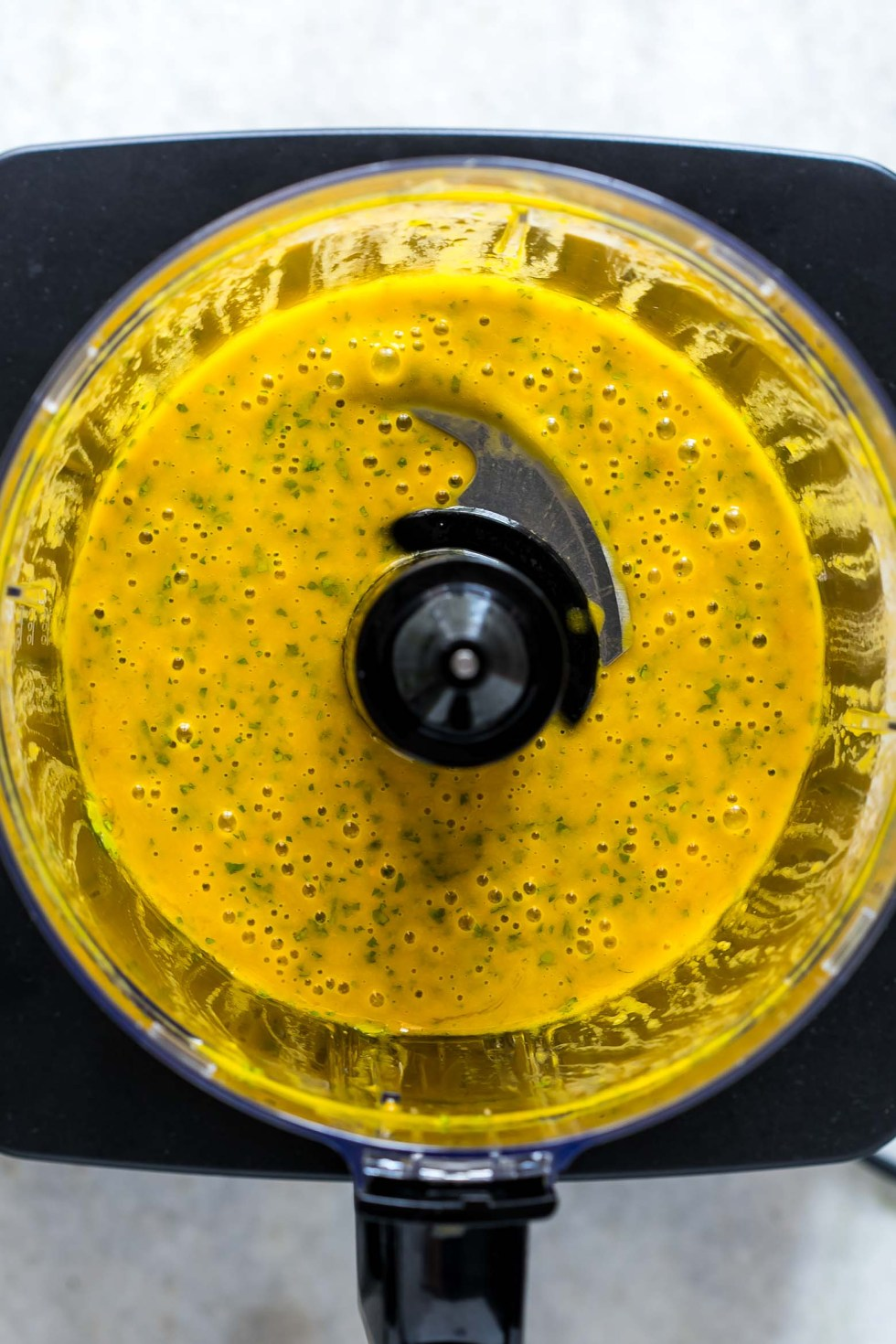 Mango Cilantro Salad Dressing is a fresh, tropical, creamy dressing that's super healthy, easily made in a blender and is gluten free. You'll want to pour it on everything!