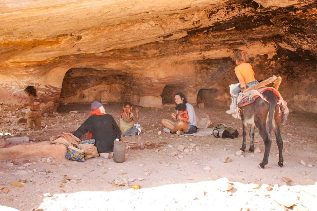 Cup of tea with locals in a cave in Petra - Jordan itinerary