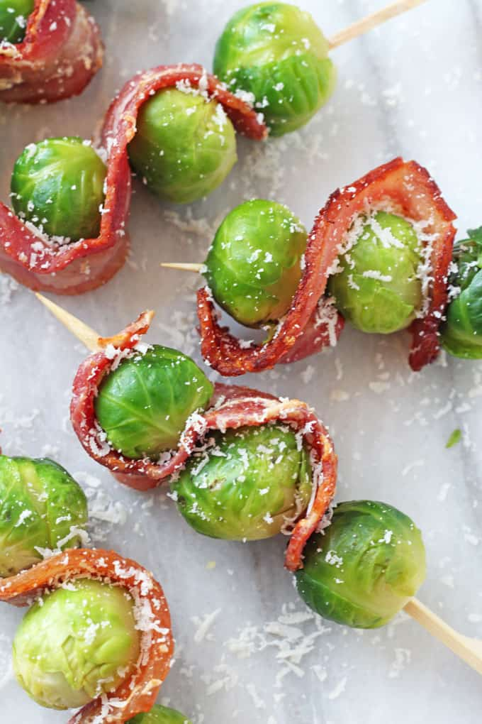 How do you get your family to eat brussels sprouts? By making these super delicious Bacon & Parmesan Brussels Sprout Skewers!