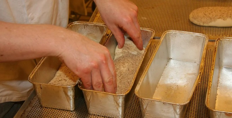 Placing dough in proofing loaf pan