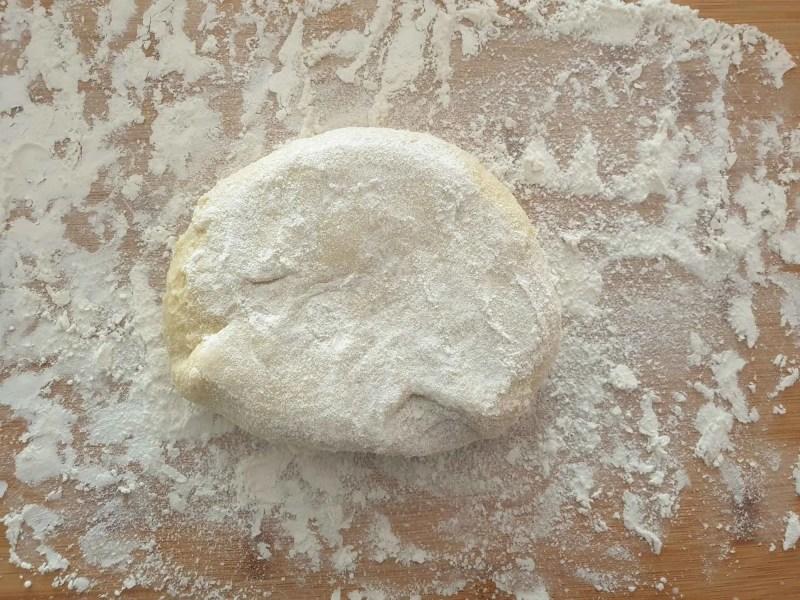 Generously floured potato dough