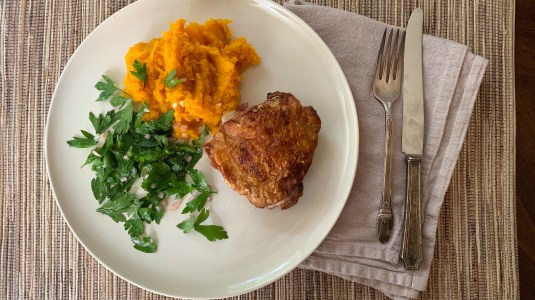 Spiced chicken thighs with curried mashed butternut squash