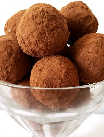 Decadent coconut truffles recipe, a delicious bite-size treat made with dessicated coconut, condensed milk and coated in cocoa powder.