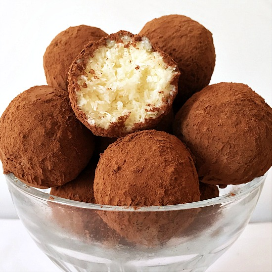Decadent coconut truffles dusted in cocoa powder