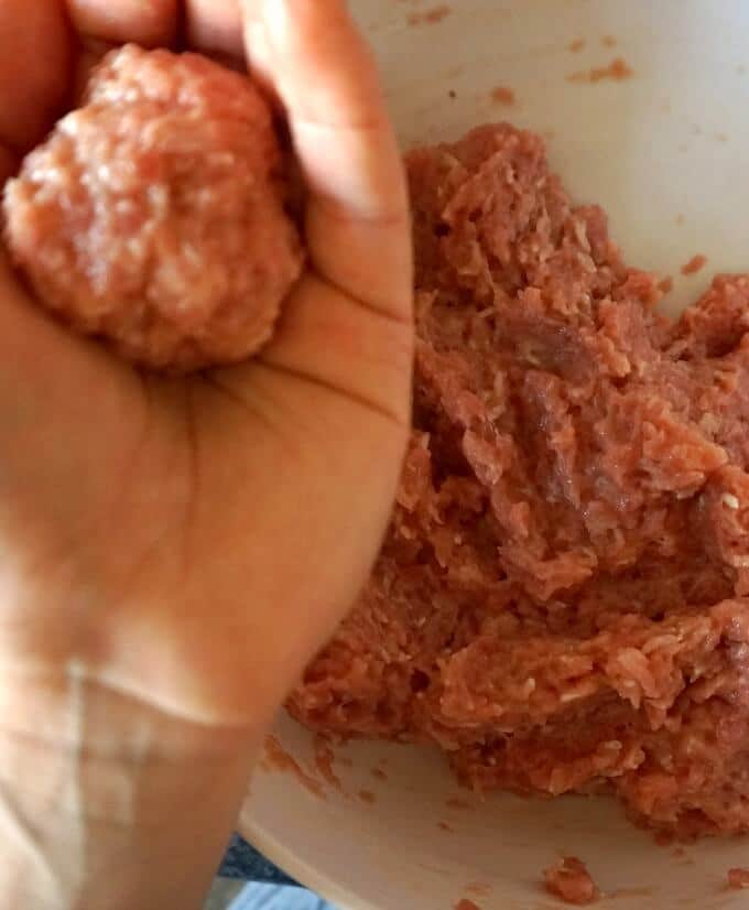 Shaping meatballs for the Romanian Meatball Soup