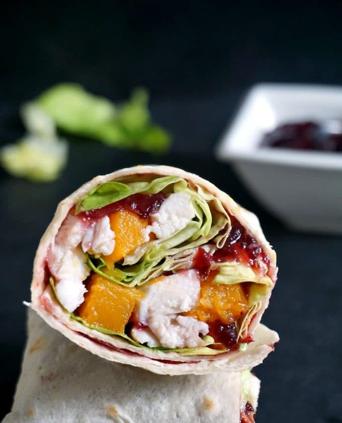 A Healthy leftover turkey wrap with cranberry sauce