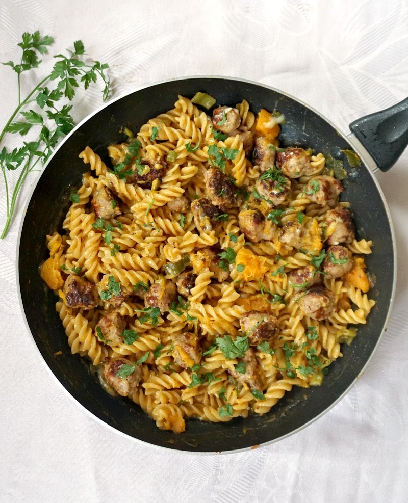 One-pan butternut squash sausage pasta in a non-stick skillet, a hearty dinner for the whole family.