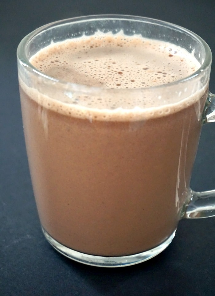A galss on homemade hot chocolate on a black background