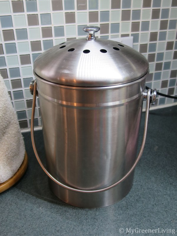 stainless steel gallon compost pail on a kitchen counter