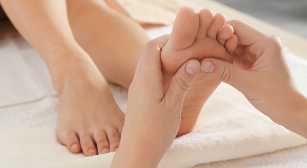 person giving foot massage