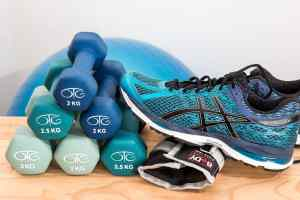 Physical injury chiropractor in west palm beach shows tennis shoe and weights for physical therapy
