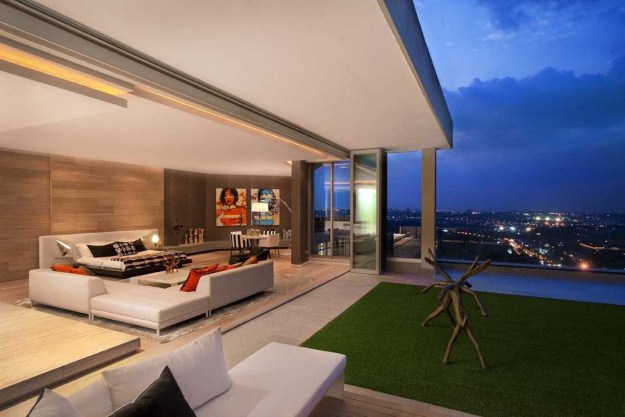 Living Room and Outdoor Garden with City View by Saota and Okha Interiors.