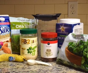 Ingredients for healthy mocha protein shake with spinach