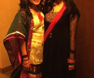 Friends at an Indian wedding in beautiful Indian outfits