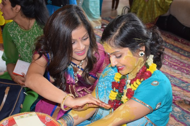 Sister and bride at Hindu pithi vidhi ceremony