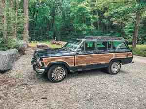 dad-daughters-camping-adventure-jeep-grand-wagoneer
