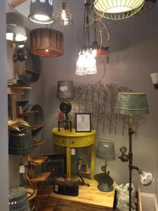 Great selection of upholstered pieces, light fixtures and artwork at Designs by Ave in downtown St. Charles.