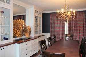 She fell in love with the fabric on the window treatment, so navy and red became the color scheme for the entire room.
