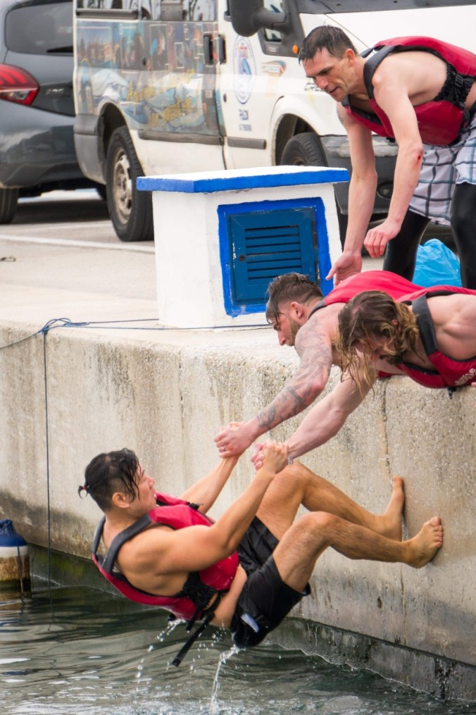 Hugh being pulled out of water