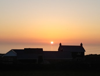 sunset over pendeen