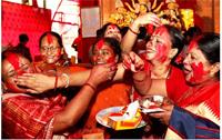 Sindur Khela will be played on Dashami of Durga Puja in 2015.