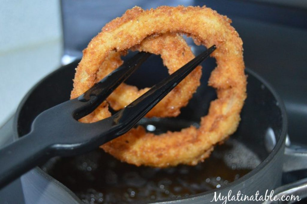 Frying onion rings to a golden brown.
