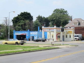Freshly-painted service station near site of Detroit's 1967 civil unrest