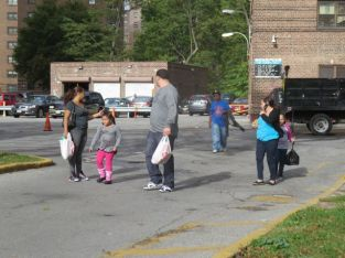 Latino family strolls to Target (Marble Hill Projects).