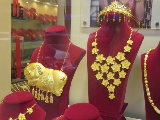 """Prosperity"" jewelry made of metal thinly coated in low-karat gold."