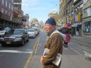 Weathered old man braves Canal Street.