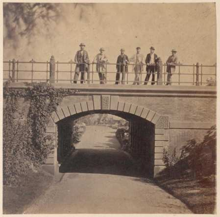 "Figure 18. ""Men standing on Willowdell Arch."" The chief engineers and architects pose for an 1862 photo above one of the park's signature tunnels."