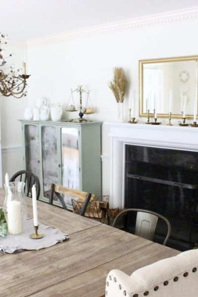 Simple neutral fall colors in our dining room- dining room- fall decor- neutral- living spaces- gold- brass- candlesticks-milk glass- fireplace decor mantel- decorating for fall- seasonal