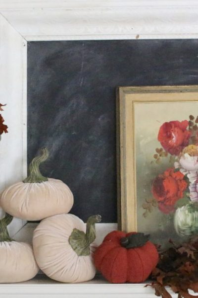 A vintage fall mantel- vintage- fall- classic- mantel- brass- fall decor- fall decorating- mantle- brass animals- velvet pumpkins- room design- mantel decor- decorating your mantel for fall- classic autumn decor- oil paintings- black tray