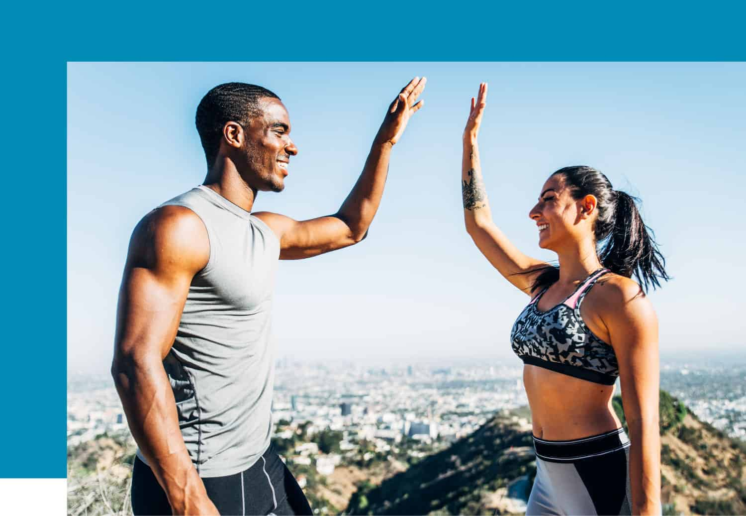 Young couple exercising exercising high five