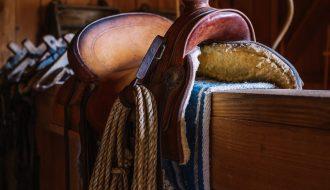 western saddle in a barn