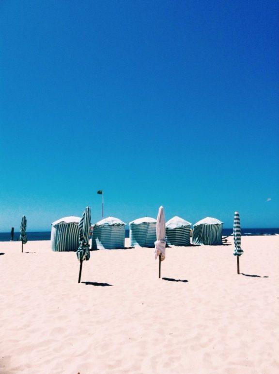 colourful striped beach huts at Figueira da Foz beach Portugal