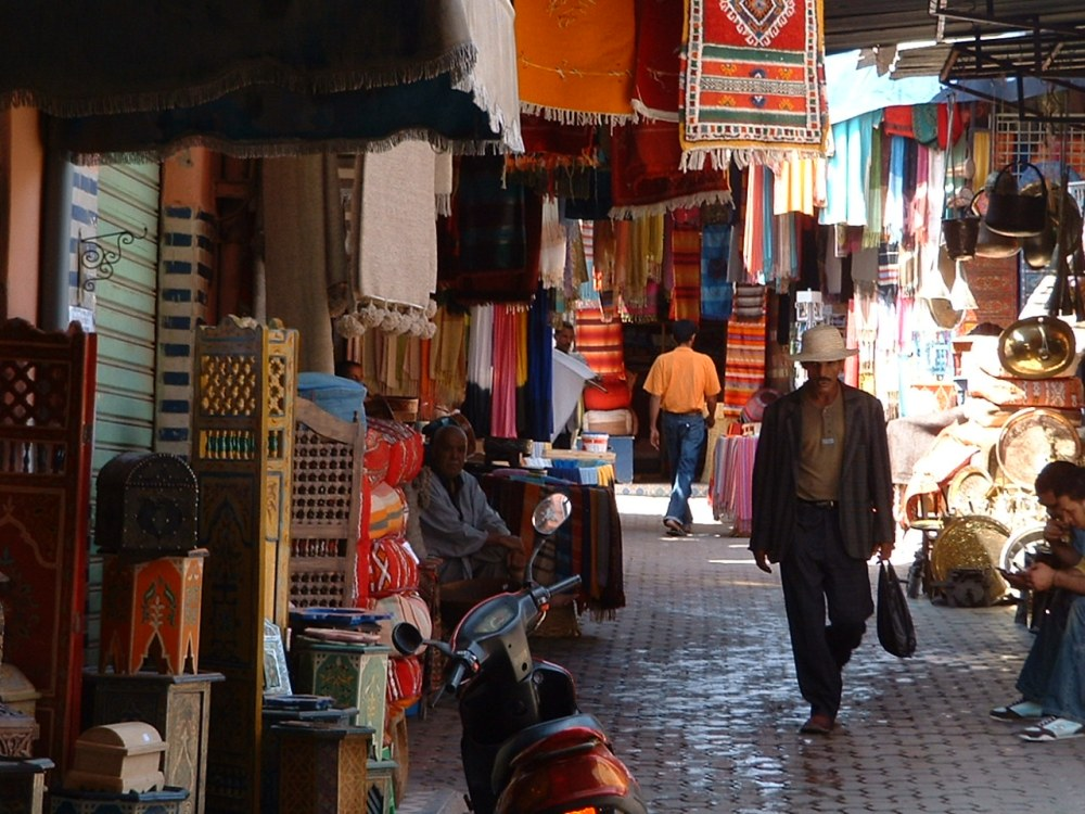 a man walking in the souks of marrakech