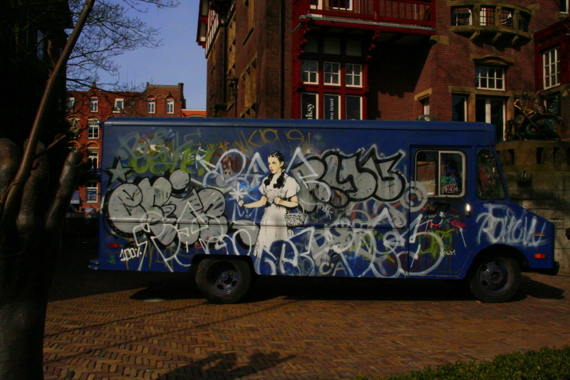 A van spray painted by Banksy at the Banksy and Dali exhibition at Amsterdams MOCO - a definite recommendation for your Amsterdam weekend break