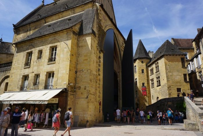 Sarlat indoor market with the huge metal doors and glass elevator