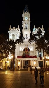 A night-time view of the Ayuntamiento (city hall) building in Valencia