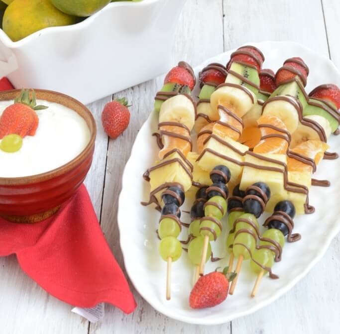 Kids' appetites dip during the hot weather & understandably so! Give them refreshing nutrition with these healthy, cooling & colorful fruit skewers for summer!