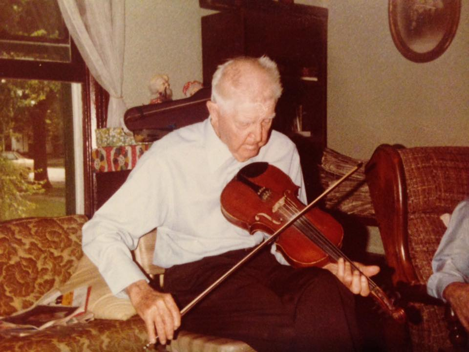 Grandpa Keller playing violin shared by Brennan twins