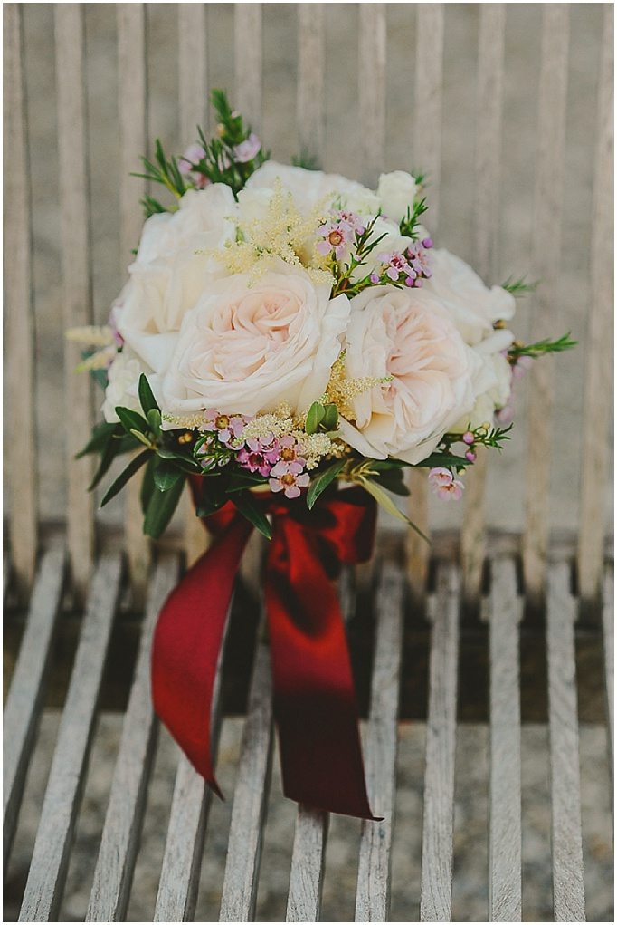 Rustic wedding in Tuscany - Featured on My Lovely Wedding Blog.  - Beautiful bridesmaids bouquet tied with a red ribbon.