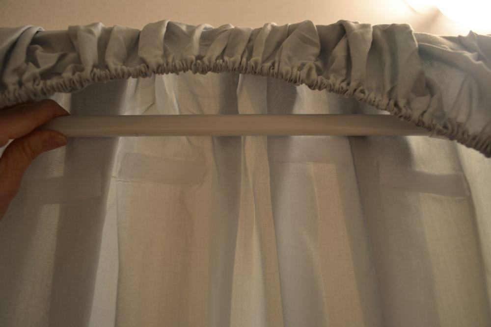 place rod into top of fitted sheet