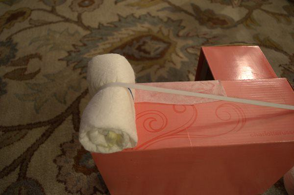 Place rolled Diaper under Elastic