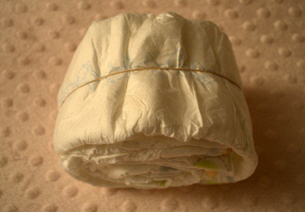 Roll 8 Diapers to make the Baby's butt