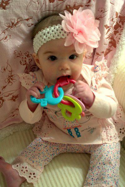 playing with teething ring