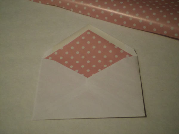 Slide cutout into envelope