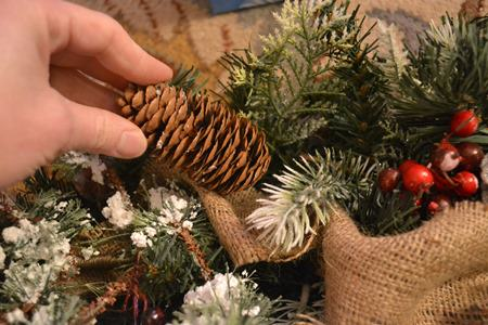 Decorate Swag with Pinecones